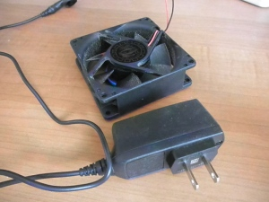 Computer cooling fan and cell phone charger